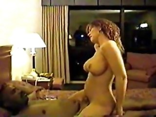 Curvy milf with incredible big tits grinds on...